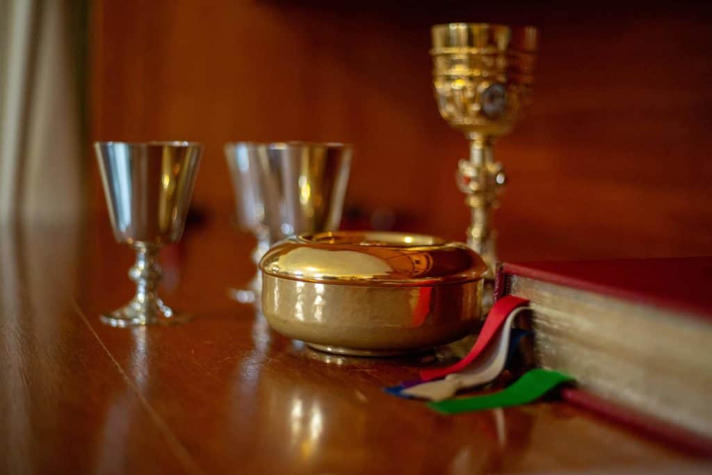 A Missal, Chalices, and Ciborium in the sacristy ofLittle Flower Catholic Church before Mass