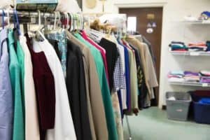 Rows of donated clothes available for the poor at St. Teresa of Calcutta Mission atLittle Flower Catholic Church
