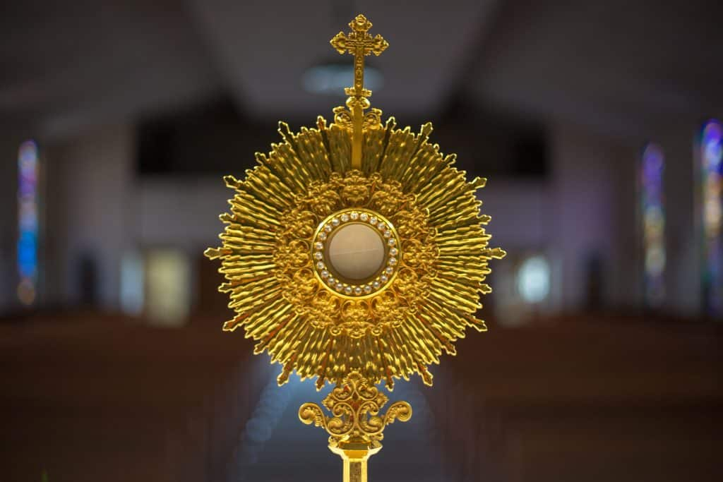 A monstrance with a host up close pictured during an afternoon of adoration at Little Flower Catholic Church