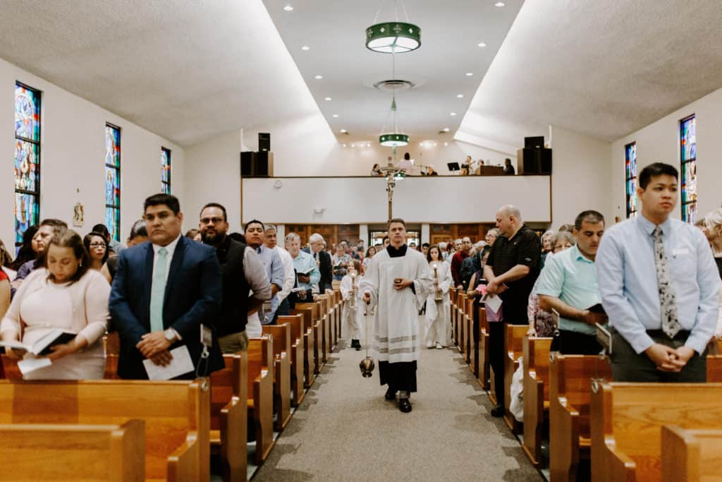 Kevin Wessa leads the procession with incense at the 2019 Confirmation Mass at Little Flower Catholic Church