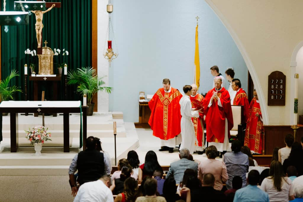 Bishop Bill Wack reads the closing prayer from the Missal at the 2019 Confirmation Mass at Little Flower Catholic Church