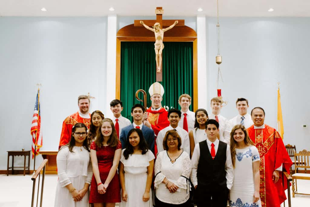 Bishop Bill Wack pictured with Fr. Matt Worthen and all students recently confirmed at the 2019 Confirmation Mass at Little Flower Catholic Church